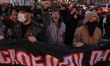 Activists of the Svoboda Ukrainian nationalist party shout slogans as they take part in a rally in Kiev