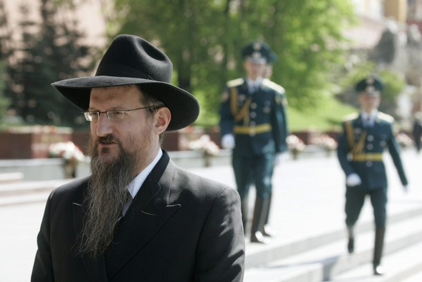 Russia's Chief Rabbi Berl Lazar takes part in a wreath laying ceremony at the Tomb of the Unknown Soldier in central Moscow