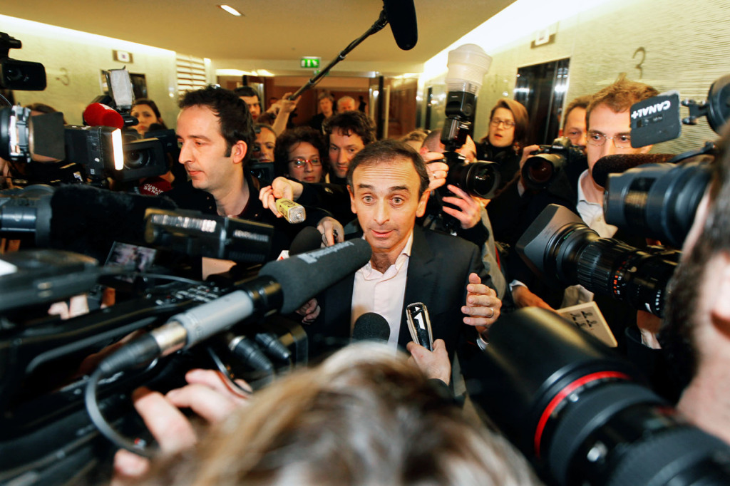 French journalist Eric Zemmour leaves after delivering a speech at UMP political party's conference at the National Assembly in Paris