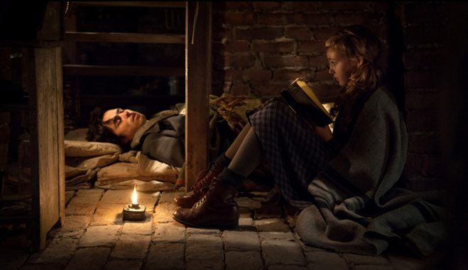 "This image released by 20th Century Fox shows Ben Schnetzer, left, and Sophie Nélisse in a scene from ""The Book Thief,"" about a girl who loves books. (AP Photo/20th Century Fox, Jules Heath)"