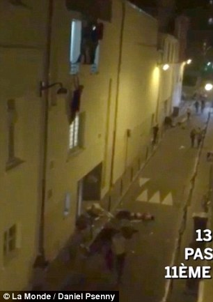 2E6F585800000578-3317960-The_footage_shows_a_woman_hanging_from_the_second_floor_window_o-a-4_1447494990822