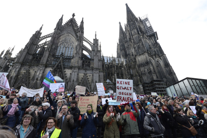 People take part in a demonstration against violence against women in front of the cathedral in Cologne, western Germany, on January 9, 2015 where sexual assaults in a crowd of migrants took place on New Year's Eve. / AFP / Roberto Pfeil (Photo credit should read ROBERTO PFEIL/AFP/Getty Images)